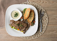 Beef filet steak served with bread, vegetables, mushroom and mustard Stock Photography