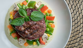 Beef filet steak served with mashed potatoes and vegetables Stock Photography