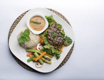 Beef filet steak served with rice, vegetables, and mushroom Stock Images