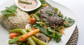 Beef filet steak served with rice, vegetables and mushroom Royalty Free Stock Image
