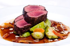 Beef fillet. On plate with vegetables Stock Images