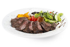 Beef fillet grilled with vegetables. Beef fillet grilled with tomato, pepper, cucumber and herbs. Served with any sauce Stock Photography