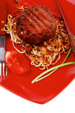 Beef fillet medallions on noodles Stock Photo