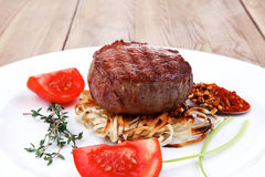 Beef fillet medallions on noodles Royalty Free Stock Photography