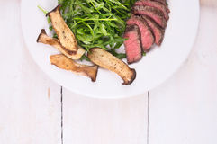 Beef fillet with mushrooms and Arugula Royalty Free Stock Images