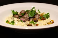 Beef Fillet and potato with gorgonzola cream stock photo