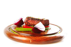 Beef fillet served on wooden plate Royalty Free Stock Photography