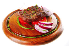 Beef fillet served on wooden plate Royalty Free Stock Image