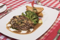 Beef fillet steak with mushroom sauce meal stock image