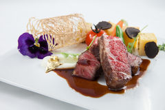 Beef fine dining. With beautiful decoration Stock Photography