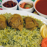 Beef  and fish Kabsa. Beef Kabsa - mixed rice dishes that originates in Yemen. Middle  eastern food Royalty Free Stock Photography