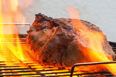 Beef in flames on grill Royalty Free Stock Image