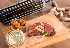 Beef flank steak with toasted almonds and saffron potatoes royalty free stock photo
