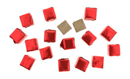 Beef flavored bouillon cubes wrapped and unwrapped. Top view of several beef flavored bouillon cubes in red tinfoil wrappers plus two unwrapped ready to use Royalty Free Stock Images