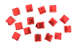 Beef flavored bouillon cubes wrapped on a white background. Top view of several beef flavored bouillon cubes in red tinfoil wrappers isolated on a white Stock Photos