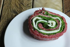 Beef Florentine Pinwheel. Precooked beef Florentine pinwheel on plate royalty free stock photo
