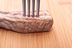 Beef with fork Stock Image