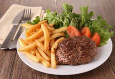 Beef and french fries Stock Image