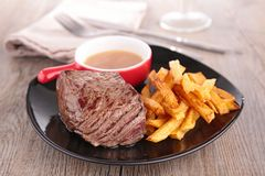 Beef and french fries Royalty Free Stock Photo