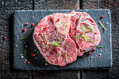 Beef with fresh herbs on a stone plate Stock Photos