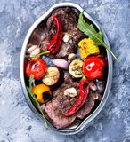 Grilled meat and vegetables Stock Images