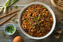 Beef Fried Rice. Delicious beef fried rice with egg, carrot, garlic, green peas and scallions Royalty Free Stock Photo