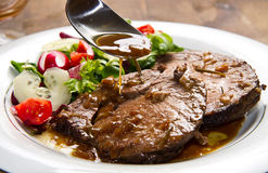 Beef  garnished with fresh salad Stock Images