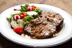 Beef  garnished with fresh salad Stock Photo