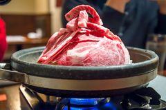 Beef on gas stove (cooking beef) Stock Image