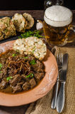 Beef goulash with dumplings stock photos