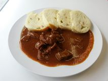Hungarian beef goulash. Beef goulash and dumplings on the plate Royalty Free Stock Image