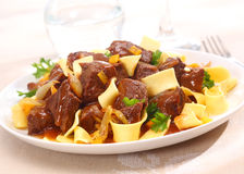 Beef goulash with noodles Stock Photos