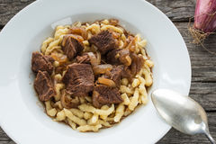 Beef goulash with noodles Stock Images