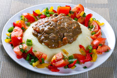 Beef goulash with potatoes and vegetables. Salad Royalty Free Stock Images