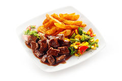 Beef goulash in a rich gravy with mixed veggies Royalty Free Stock Photo