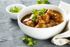 Beef goulash. With tomatoes and herbs Stock Photography