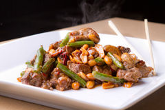 Beef and green bean stir fry with peanuts Stock Photo