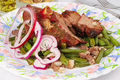 Beef with green beans, red onion rings, bacon Royalty Free Stock Image
