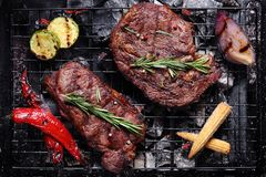 Beef on the grill with vegetables. Grilled beef on the grill with vegetables Royalty Free Stock Photos