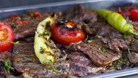 Beef grilled with green peppers and tomatoes royalty free stock photo