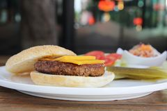 Beef hamburger fastfood. On a wooden tray stock photography