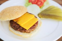 Beef hamburger fastfood. On a wooden tray royalty free stock photos