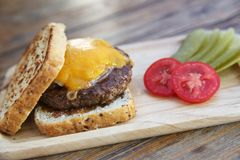 Beef hamburger fastfood. On a wooden tray royalty free stock photography