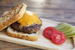 Beef hamburger fastfood. On a wooden tray royalty free stock images