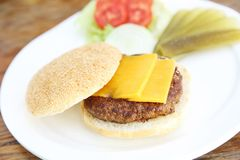 Beef hamburger fastfood. On a wooden tray stock image