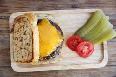 Beef hamburger fastfood. On a wooden tray royalty free stock photo