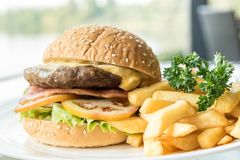 Beef hamburger. With fires and fresh vegetable royalty free stock photo