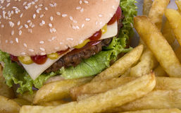 Beef hamburguerwith french fries Royalty Free Stock Photos