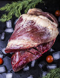 Beef heart on a black background