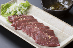 Beef heart stabbing Salt with wasabi and Ginger soy sauce on pla Royalty Free Stock Image